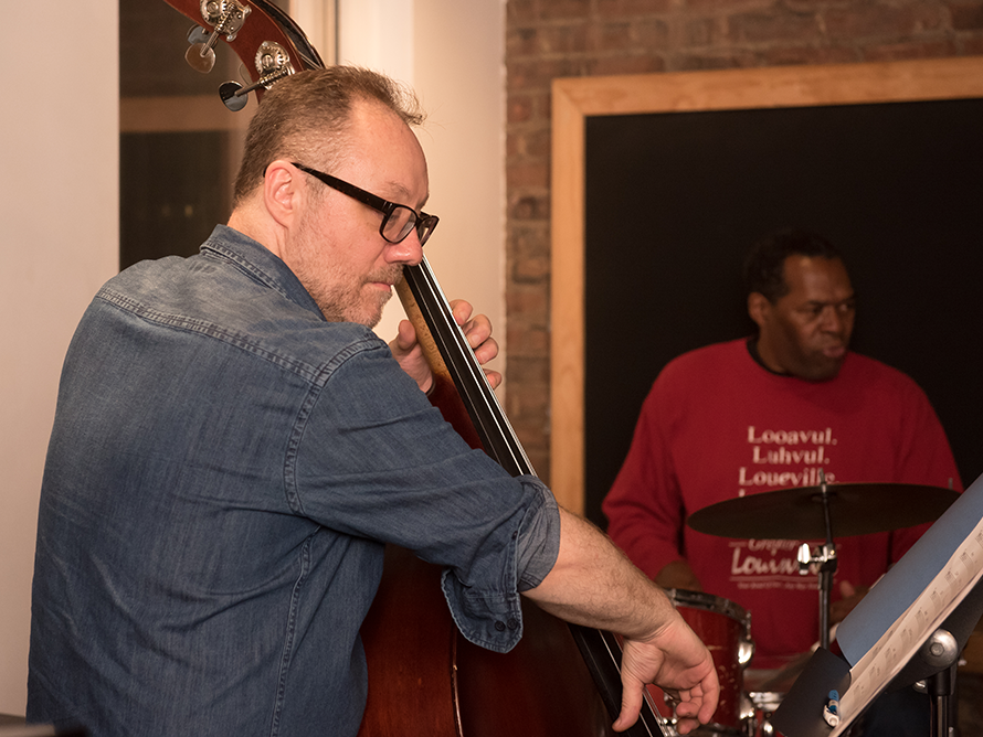Sean Conly playing bass in rehearsal with Rob Davis for his show