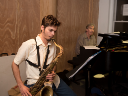Steven Frieder playing saxophone in rehearsal with Rob Davis for his show
